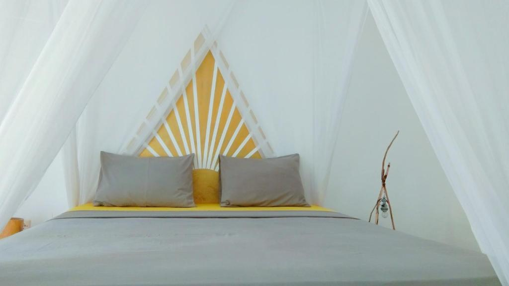 A bed or beds in a room at The Hangout
