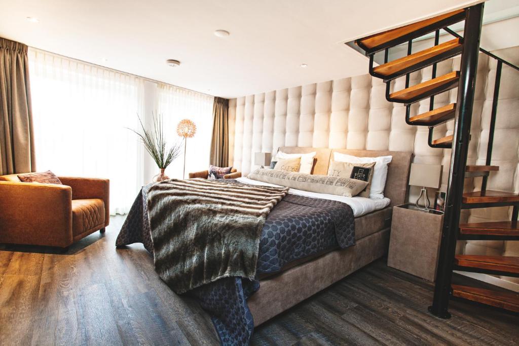 Een bed of bedden in een kamer bij City Attic Haarlem
