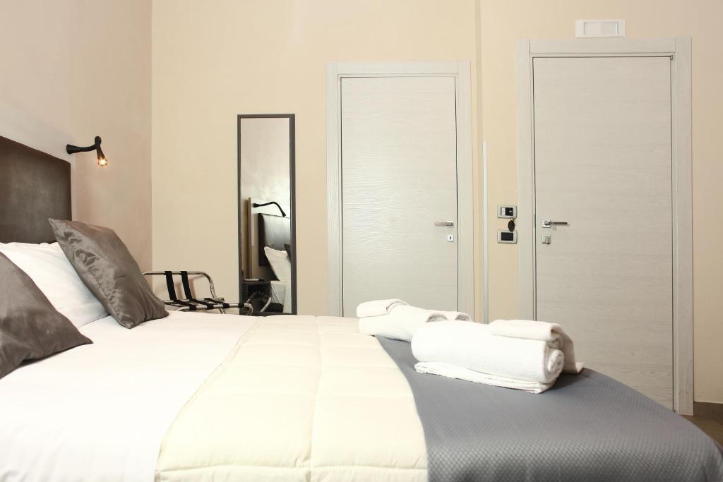 Letto o letti in una camera di Albergo Maccotta