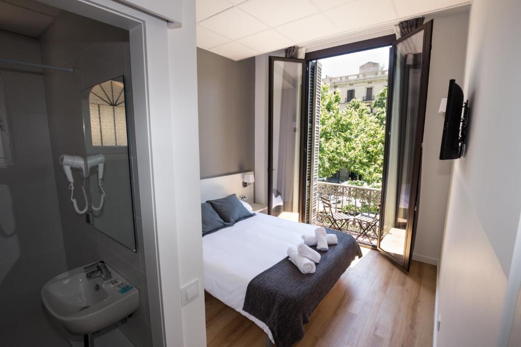 Cama o camas de una habitación en Hostalin Barcelona Gran Via