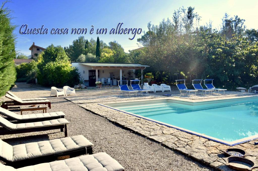 The swimming pool at or near Casa Cerqua Landi