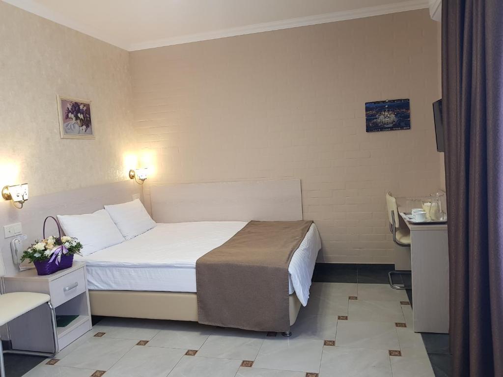 Кровать или кровати в номере Отель Оранж