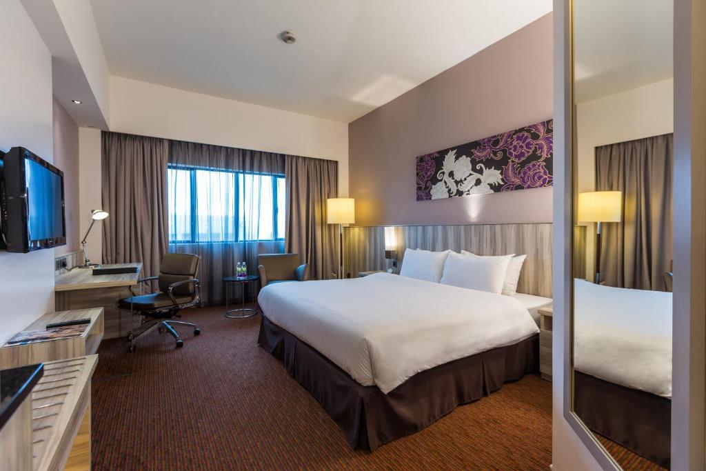 A bed or beds in a room at Sunway Hotel Seberang Jaya