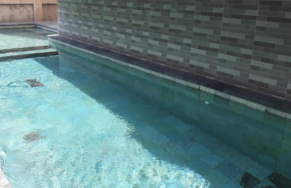 The swimming pool at or close to Mahatma Residence