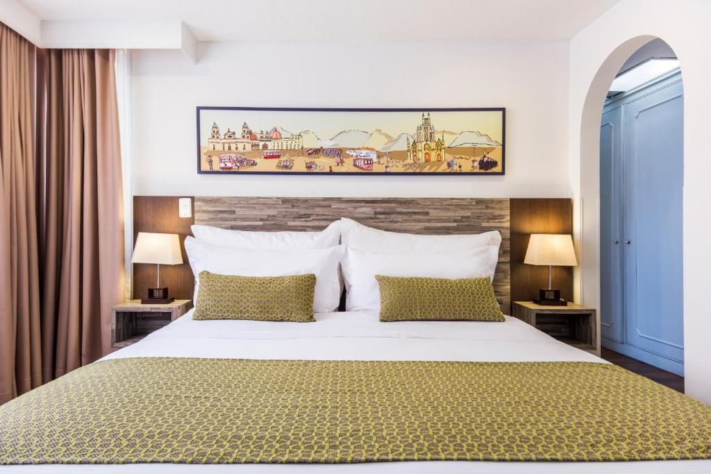 Cama o camas de una habitación en Hotel Vilar América