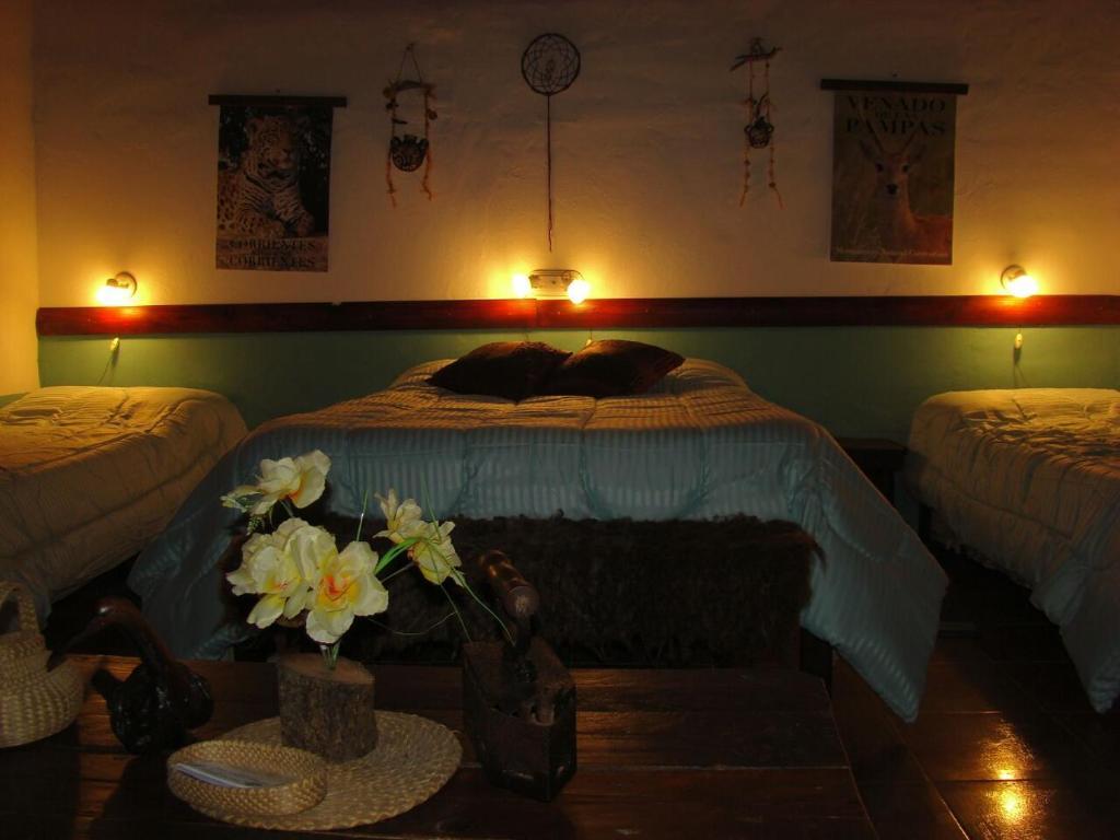 Una cama o camas en una habitación de Hospedaje San Cayetano