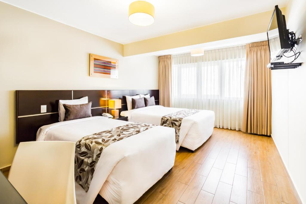 A bed or beds in a room at El Tambo 2