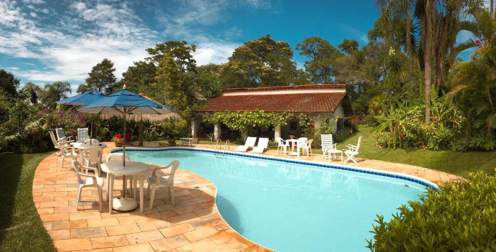 The swimming pool at or near Pousada da Gibinha