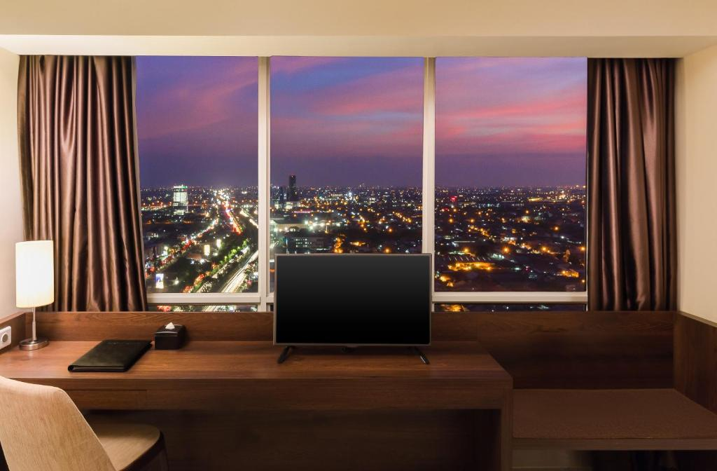 A television and/or entertainment center at Best Western Papilio Hotel