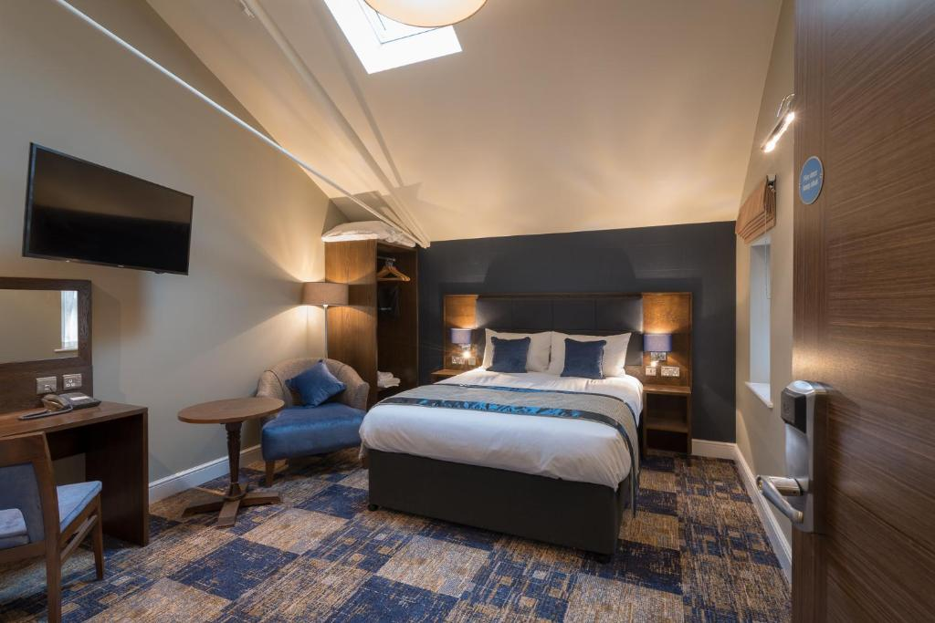 A bed or beds in a room at The John Russell Fox Wetherspoon
