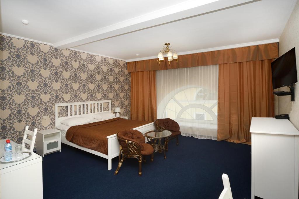 Кровать или кровати в номере Денисовский Дворик