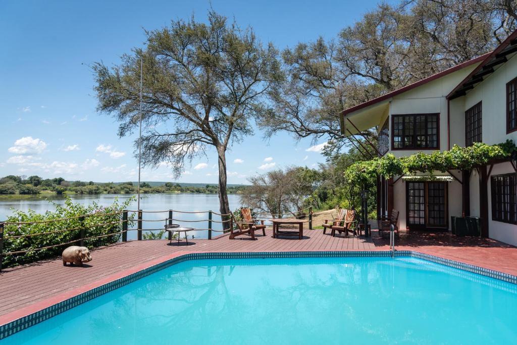 The swimming pool at or close to Kayube Zambezi River House
