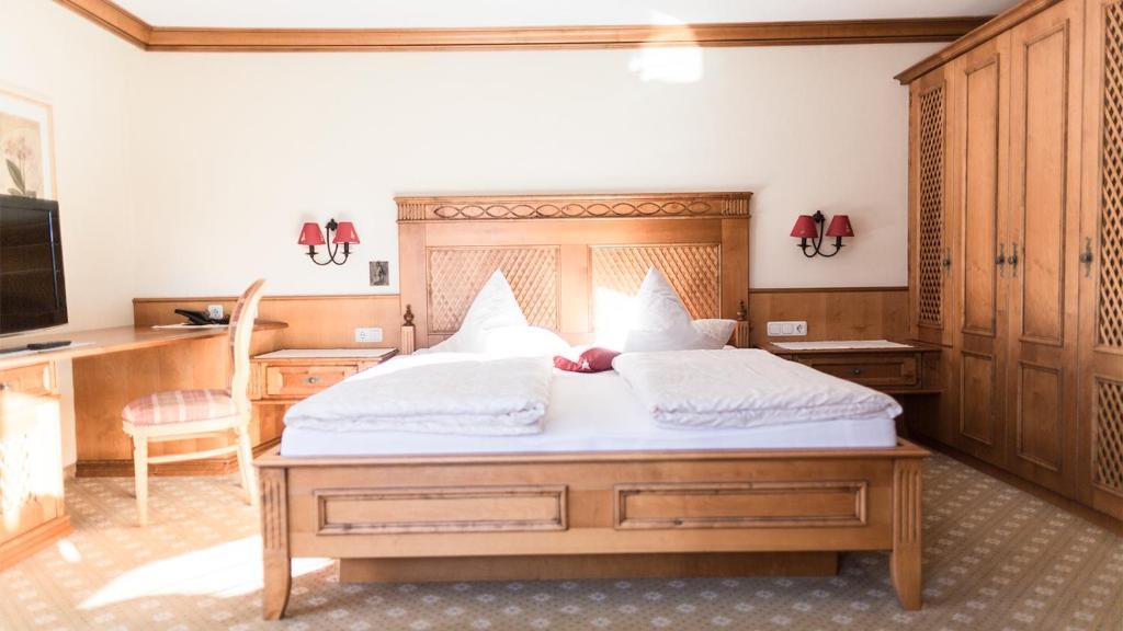 Ein Bett oder Betten in einem Zimmer der Unterkunft Triendlhof