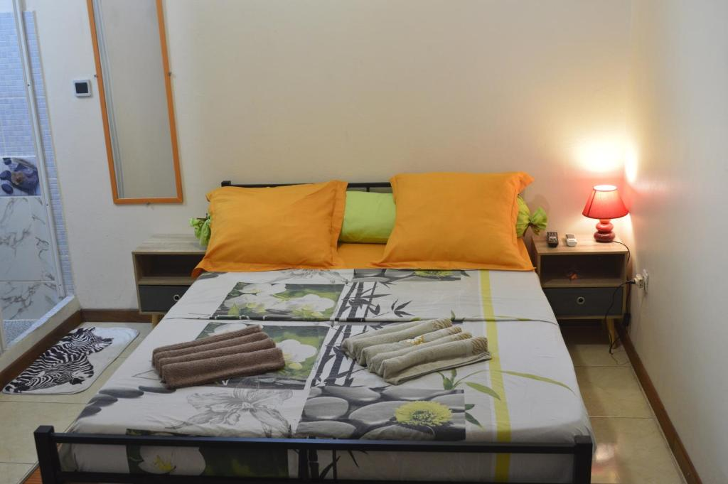 A bed or beds in a room at Résidence Plocus