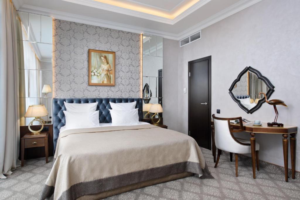 Кровать или кровати в номере Отель Парк Родник