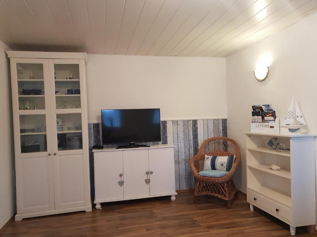TV/Unterhaltungsangebot in der Unterkunft Wohnung Nordseebriese