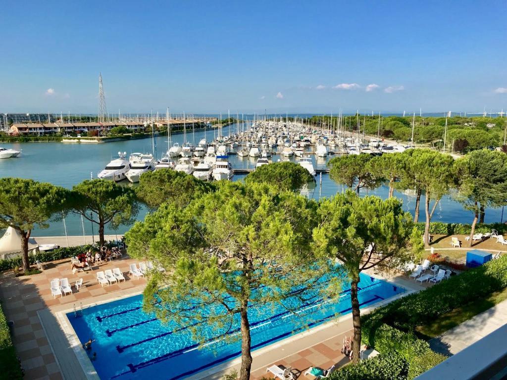 A view of the pool at Adria Marina Appartamenti Aprilia Marittima Costa Nord Adriatica or nearby