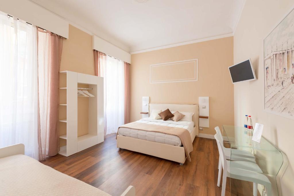 Posteľ alebo postele v izbe v ubytovaní TERMINI Smart ROOMS