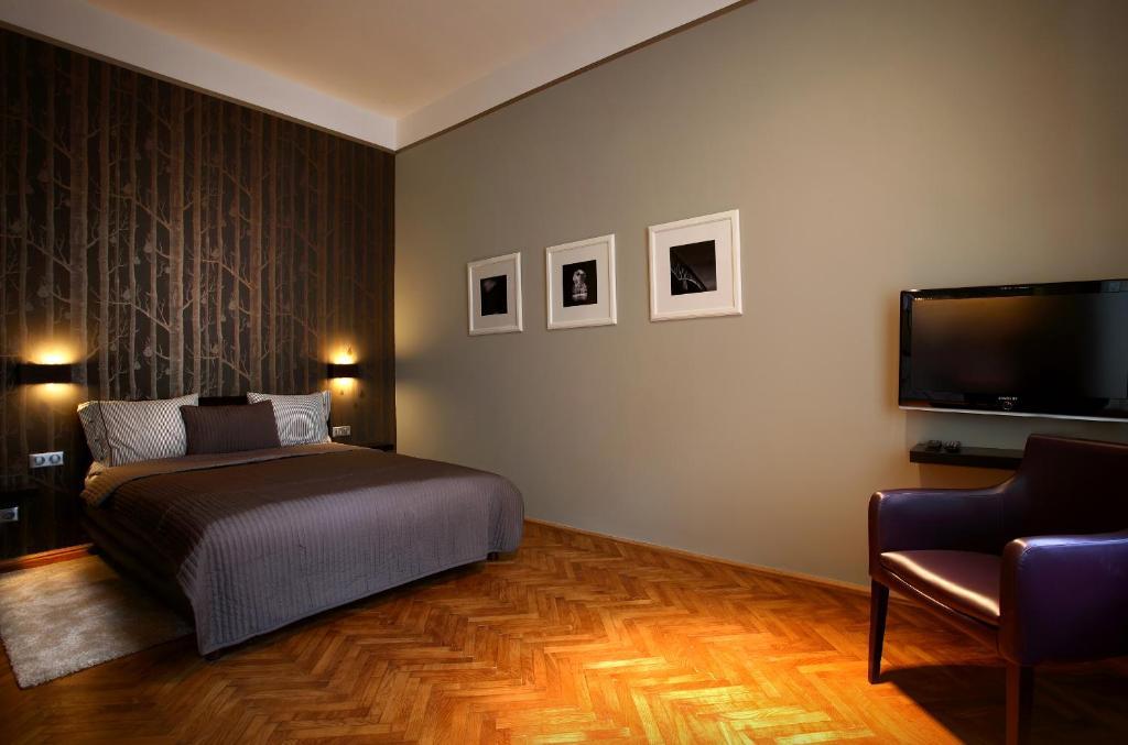 Кровать или кровати в номере Gateway Budapest City Center