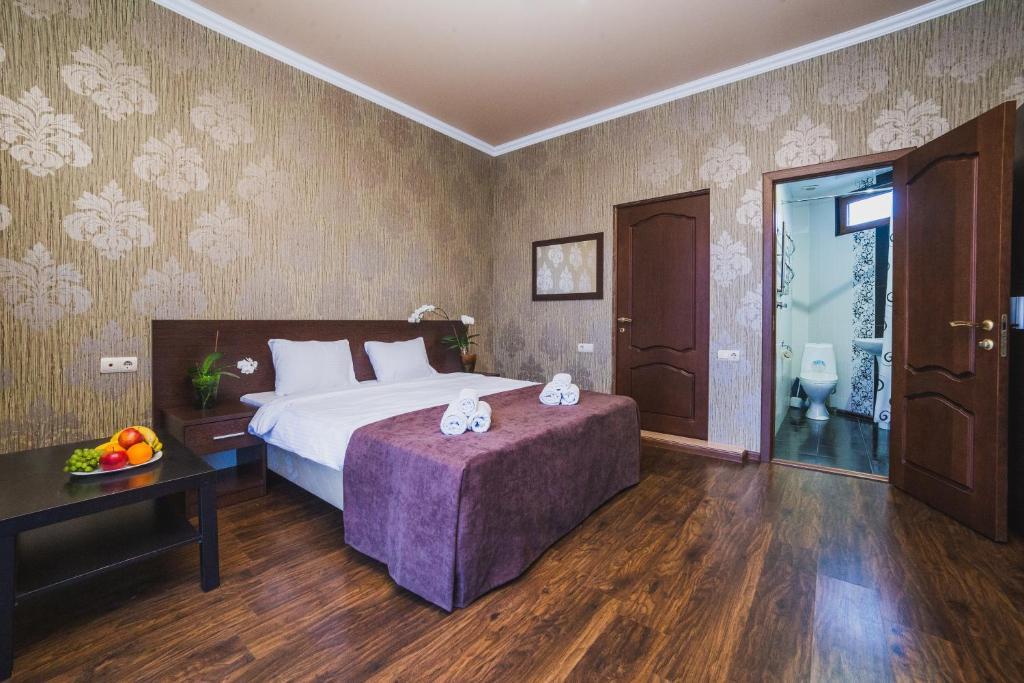 Кровать или кровати в номере Дом Тропики