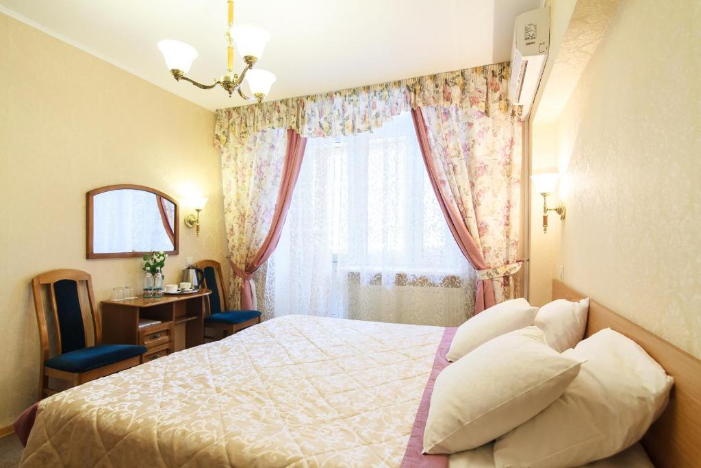 Кровать или кровати в номере Отель Никоновка