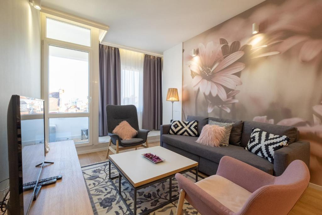 A seating area at Vitosha Boulevard Two Bedroom Two Bathroom Lux Suite