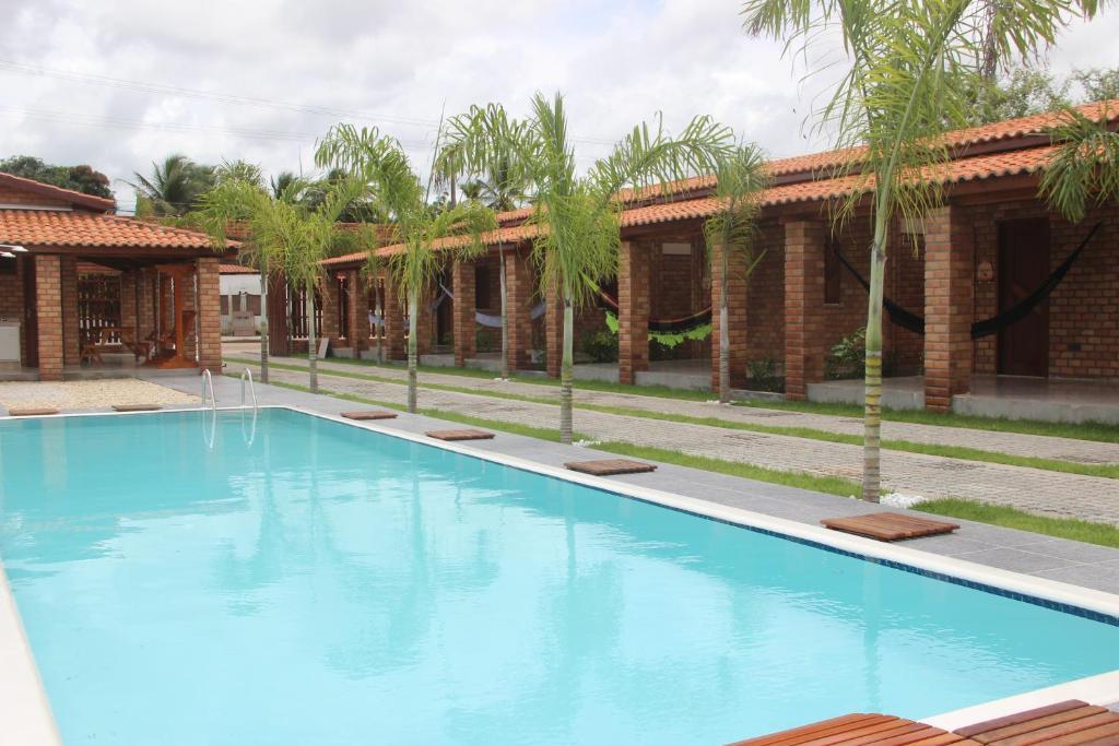 The swimming pool at or near Pousada Vasto Horizonte