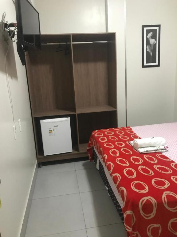 A bed or beds in a room at Hotel MM AEROPORTO BRASÍLIA