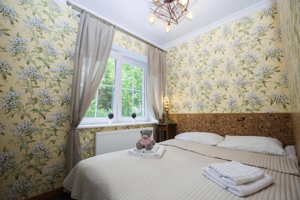 Кровать или кровати в номере Sunny Svetlogorsk 5
