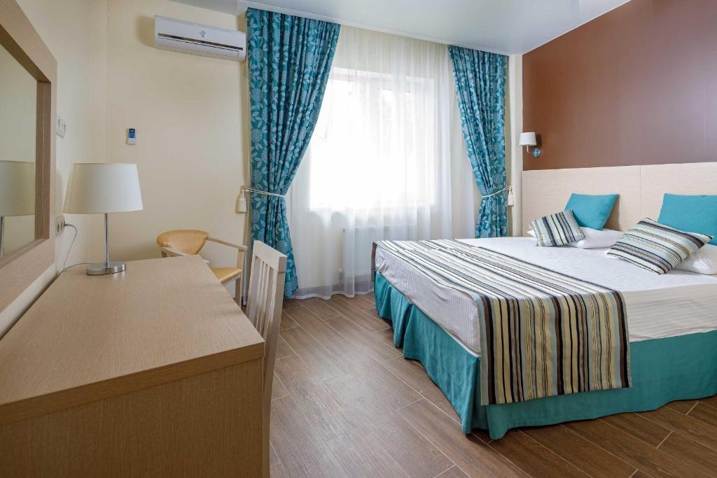 Кровать или кровати в номере Отель Панорама
