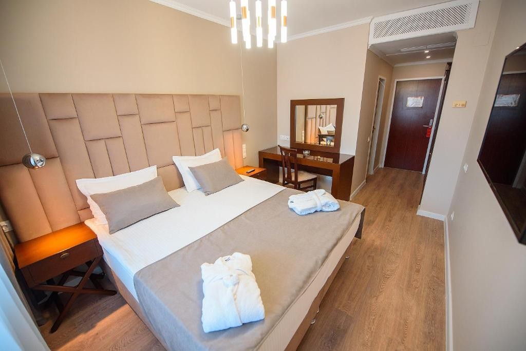 A bed or beds in a room at Astana International Hotel