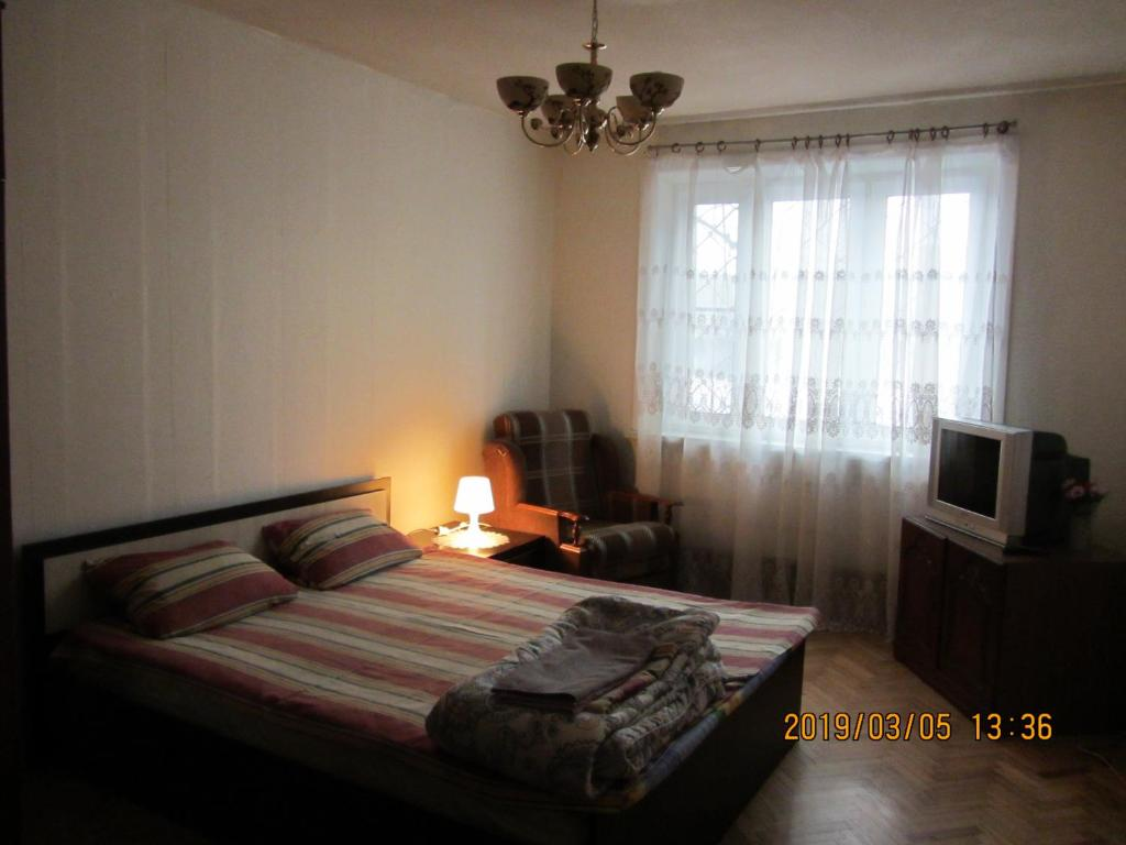 Кровать или кровати в номере Apartments Zvezda Yugo-Zapad