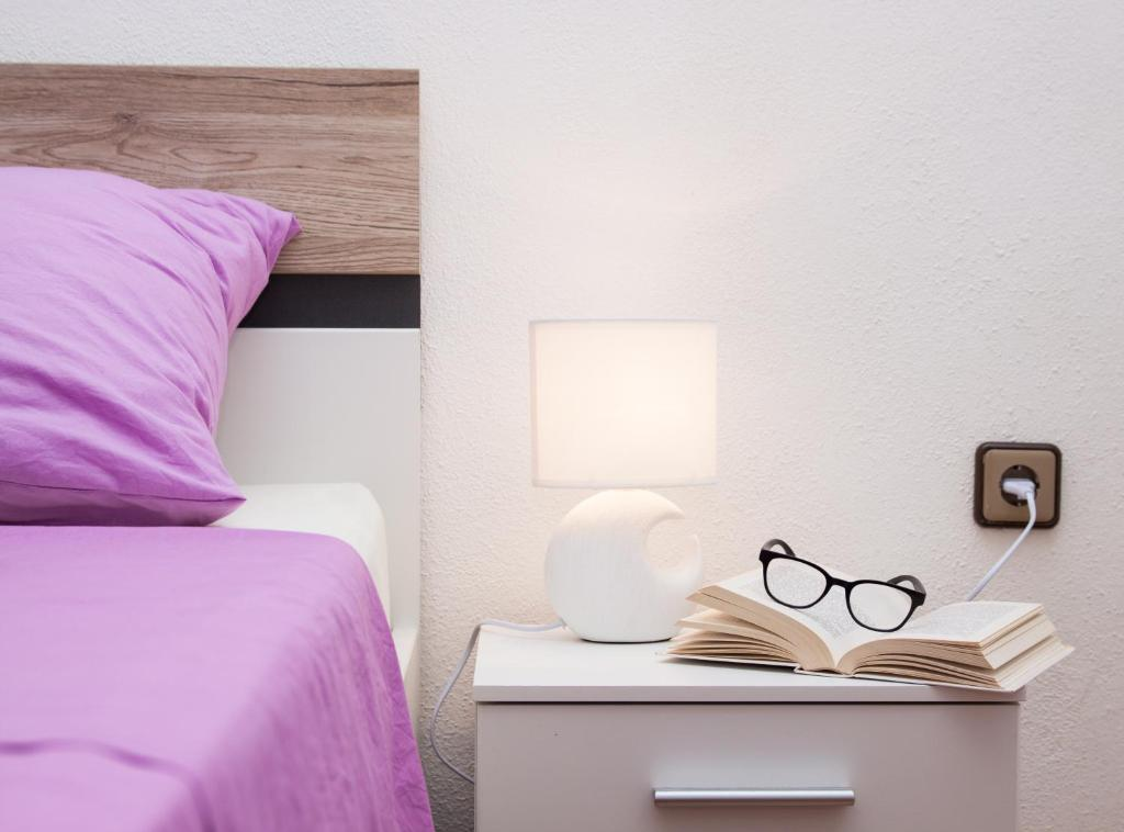 Postel nebo postele na pokoji v ubytování Nadalina Apartment