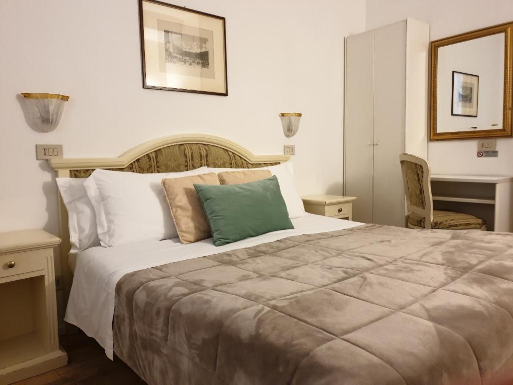 Cama ou camas em um quarto em Hotel Casa Petrarca