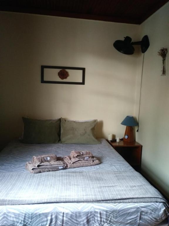 Cama ou camas em um quarto em B&B Almeida