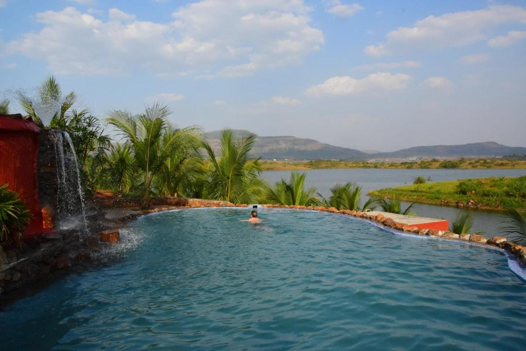 The swimming pool at or close to Fazlani Natures Nest- A Wellness Retreat