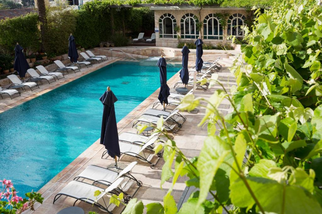 The swimming pool at or near The American Colony Hotel - Small Luxury Hotels of the World