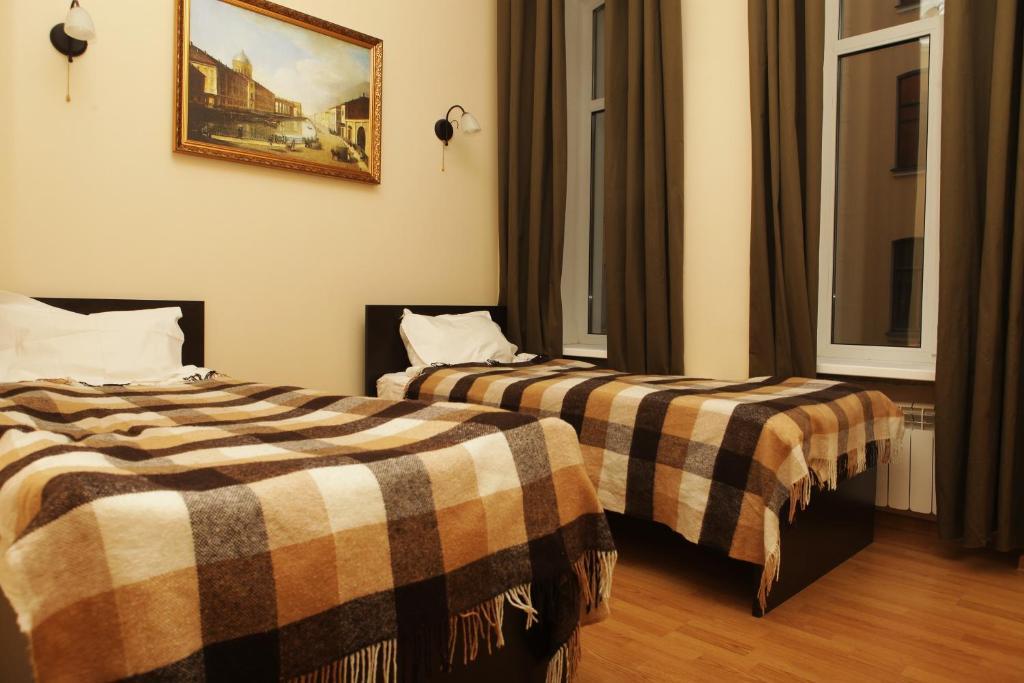 Кровать или кровати в номере Невский 156