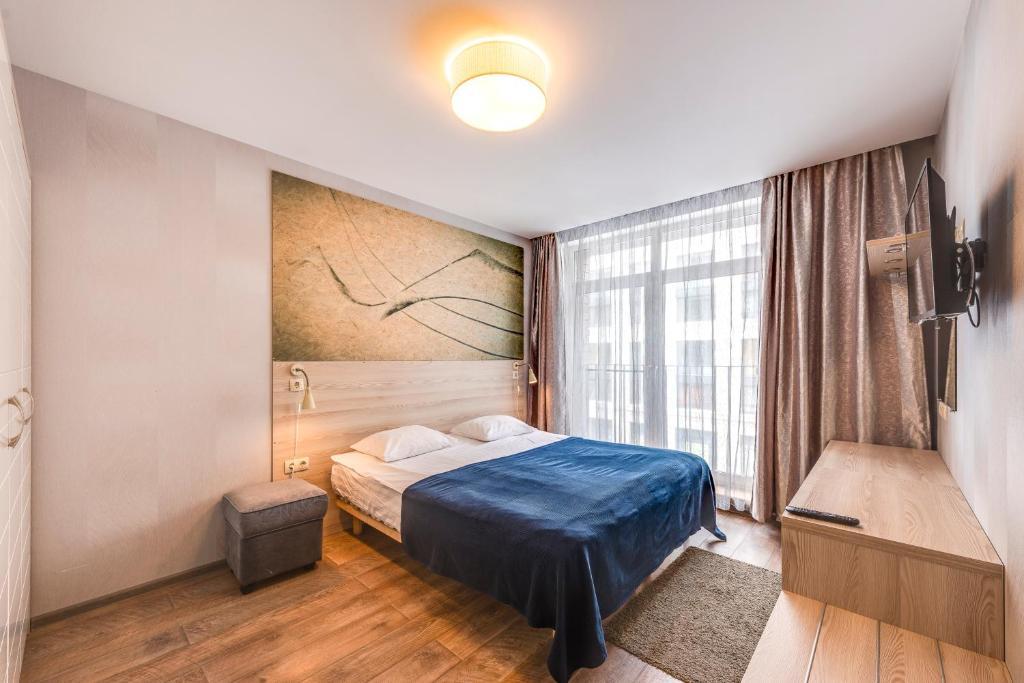 Кровать или кровати в номере Nevsky Forum Apartments