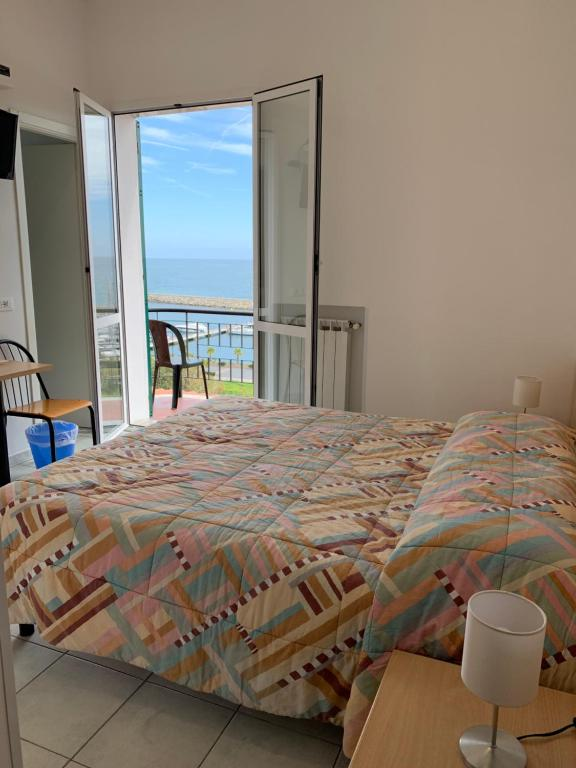 A bed or beds in a room at Baia dei Gabbiani