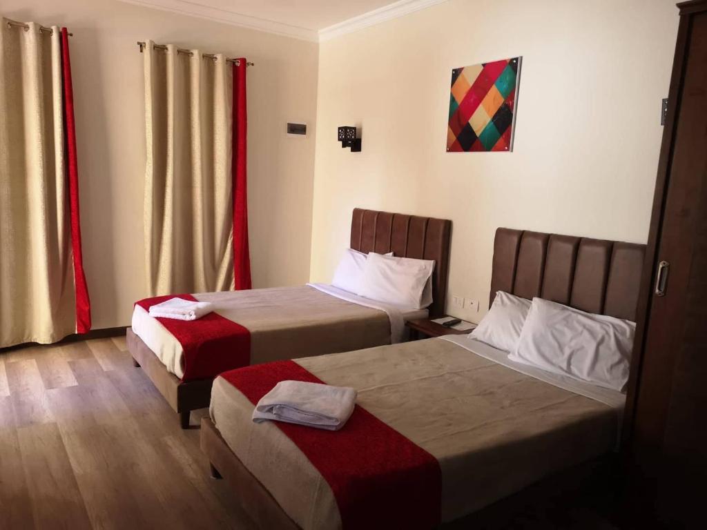 Lova arba lovos apgyvendinimo įstaigoje Cordoba Suites