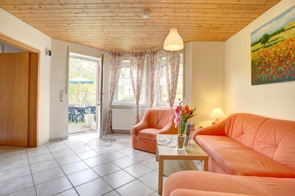 Ein Sitzbereich in der Unterkunft Apartment Liesertal