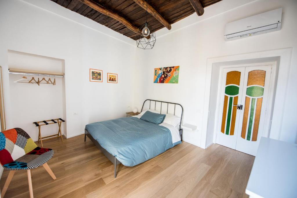 A bed or beds in a room at Stella del Mattino