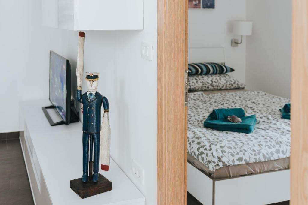 A bed or beds in a room at Apartments Vela