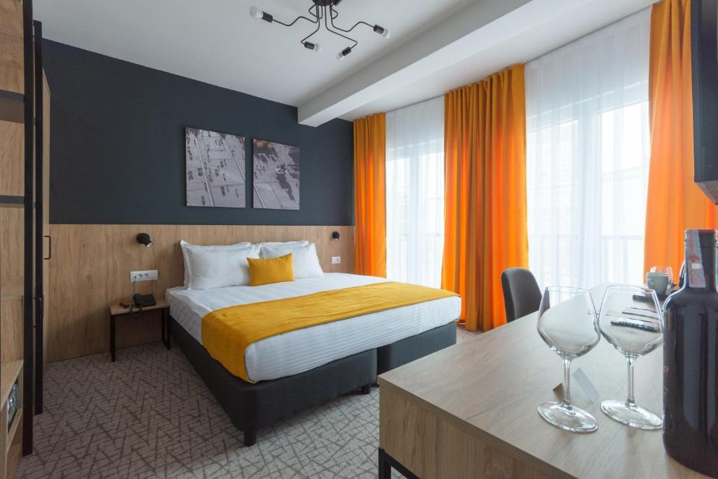 A bed or beds in a room at City Inn