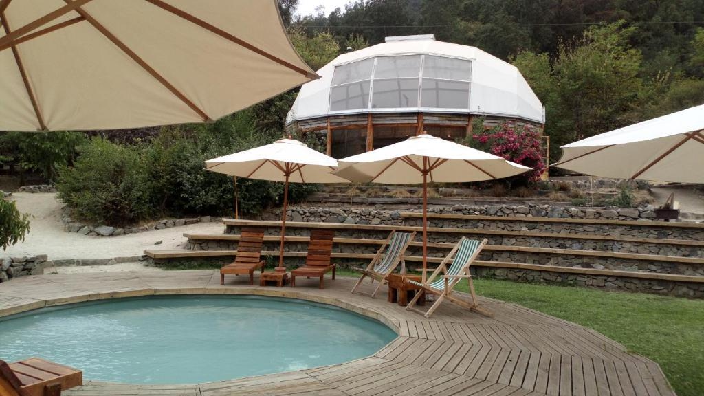 The swimming pool at or near Biosfera Lodge