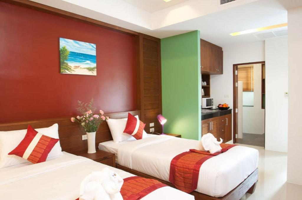 A bed or beds in a room at Samui Honey Suite