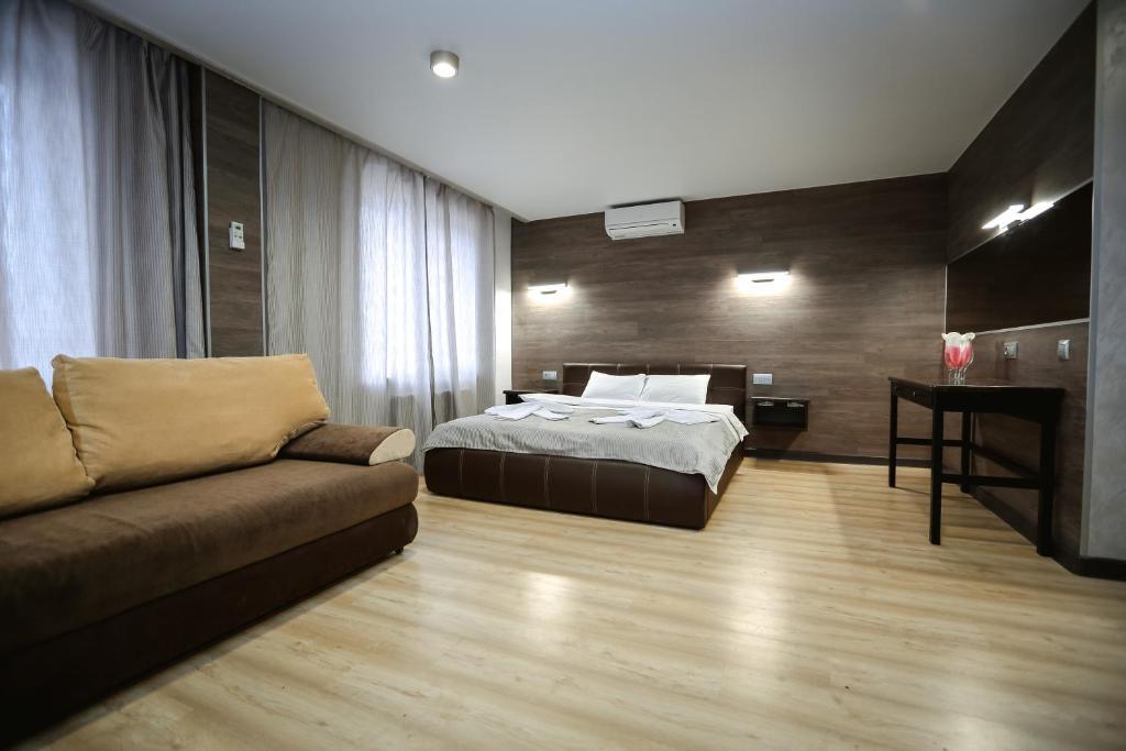 Кровать или кровати в номере Отель в Домодедово