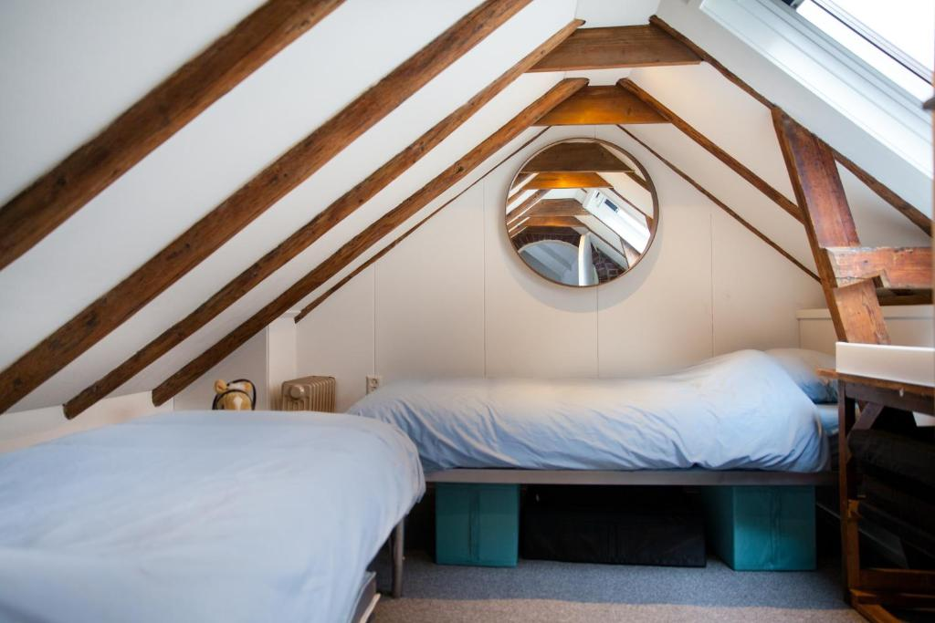 A bed or beds in a room at Skipper 4