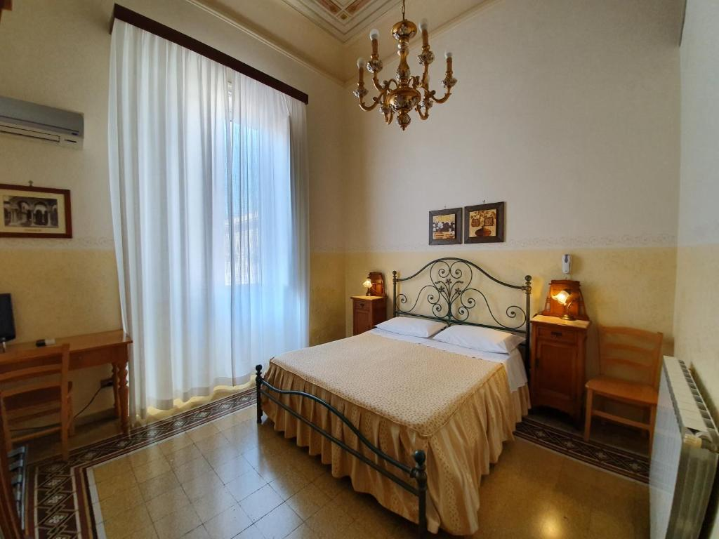 A bed or beds in a room at Albergo Cavour